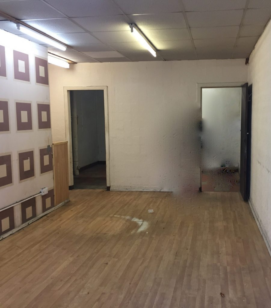 Photo of inside of new building before renovation.